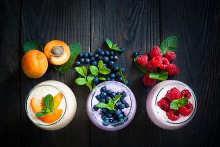 Homemade yogurt or  milkshake with fresh fruits and berries. Summer dessert. Healthy food.