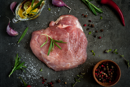Raw pork meat. Steak meat with spices and herbs on slate table. Flat lay with copy space. Stock Photo