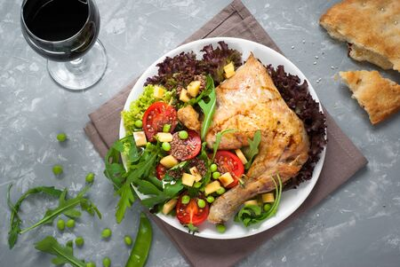 My lunch. Baked chicken with a salad of fresh vegetables and herbs. Healthy eating.