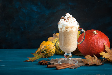Autumn hot drink. Pumpkin spice latte with whipped cream.