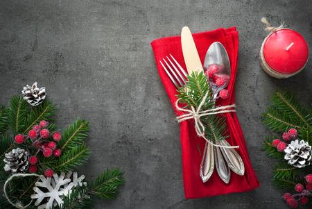 grunge cutlery: Christmas silverware at dark slate table. Top view, copy space.