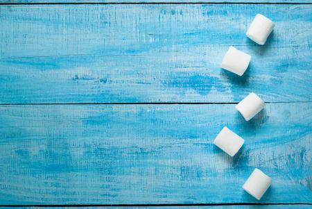 marshmellow: Fluffy white marshmallow on blue wooden table. Top view Stock Photo