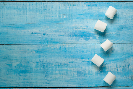 marshmellow: Fluffy white marshmallow on blue wooden table. Top view Stock Photo