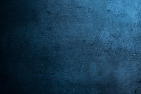 Struttura blu ardesia sfondo scuro. Pietra superficie di calcestruzzo. Archivio Fotografico