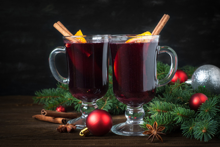 grog: Christmas hot drink with decorations. Mulled wine in glasses.