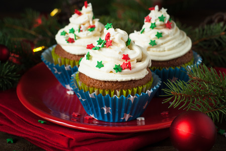 festive food: Christmas cupcakes with whipped cream topping. Christmas festive food dessert.