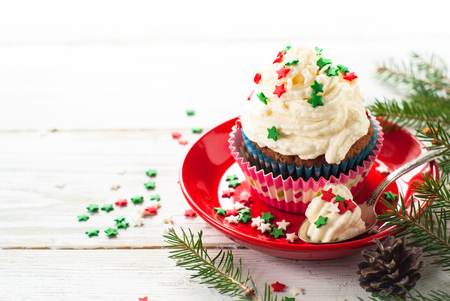 Christmas cupcakes with whipped cream topping. Christmas festive food dessert.