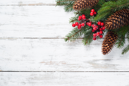 Christmas fir tree branch cone and decorations at white wooden table. Flat lay with copy space. Archivio Fotografico