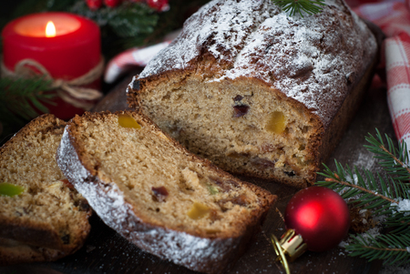 Stollen, traditional Christmas cake with dried fruits and nuts. Christmas food. Stock Photo