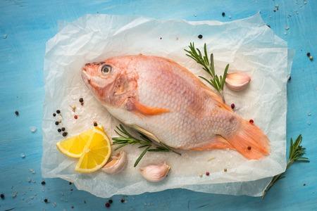 Fresh raw fish tilapia. Nile tiapia Oreochromis niloticus. Top view. Food cooking background. Stock Photo