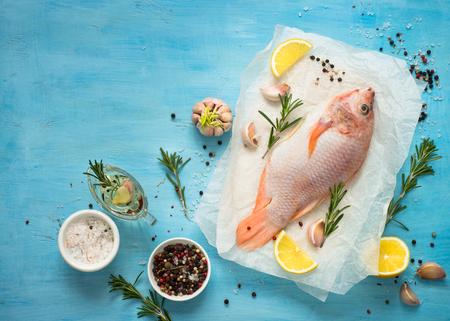 niloticus: Fresh raw fish tilapia. Nile tiapia Oreochromis niloticus. Top view. Food cooking background. Stock Photo