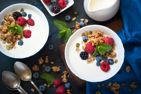 Healthy breakfast. Greek yogurt with granola and fresh berries. Top view with copy space. Stock Photo