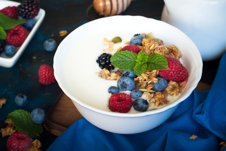Healthy breakfast. Greek yogurt with granola and fresh berries. Stock Photo