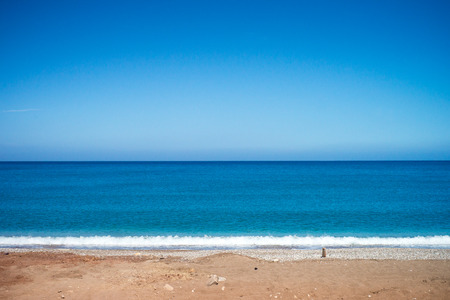 Calm blue sea and sky. Travel background. Summer vacation holiday on the beach. Stock Photo