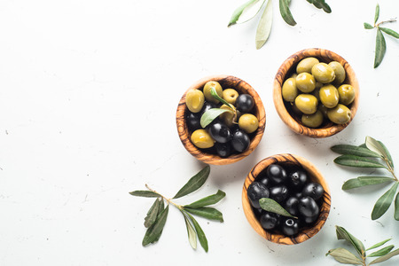 Black and green olives on white.