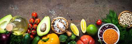 Vegetarian food background. Organic food for healthy vegan nutrition. Ingredients for cooking. Top view. Long banner format.