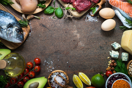 Food frame on dark stone table. Organic food for healthy nutrition. Ingredients for cooking. Top view copy space. Archivio Fotografico