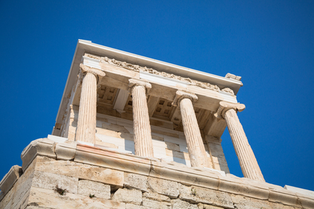 fasade: Temple of Nicky Ateros or Athena Nike at the entrance to the Acropolis. Athens, Greece. Stock Photo