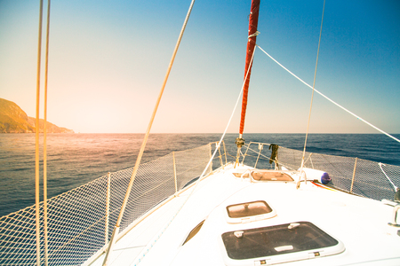 fasten: Sailing yacht on the background of the sea and mountains. Summer vacation concept.