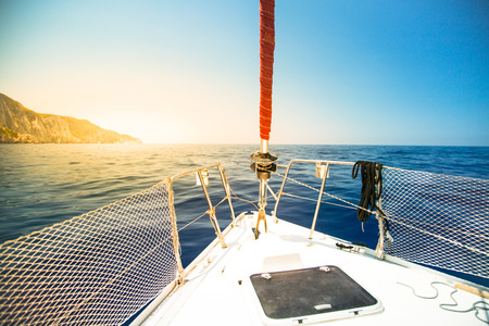 Sailing yacht on the background of the sea and mountains. Summer vacation concept.