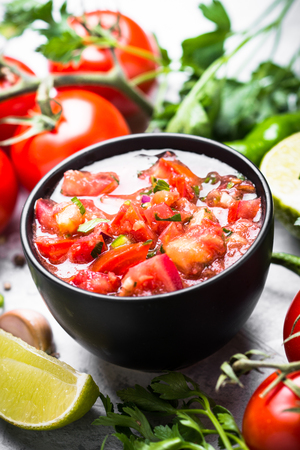 Traditional Latin American mexican  salsa sauce and ingredients on black stone table. Close up. Stock Photo