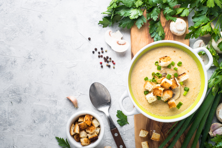 Creamy Mushroom Soup with croutons on gray  concrete table. European cuisine. top view copy space.