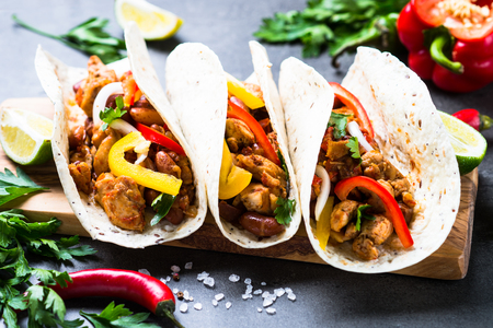 Mexican taco with meat beans and vegetables. Latin american food. Stock Photo