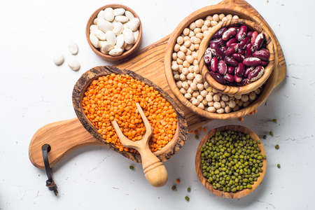 Legumes - lentils, chickpeas, beans, green mung bean on white background. Top view. Stock Photo