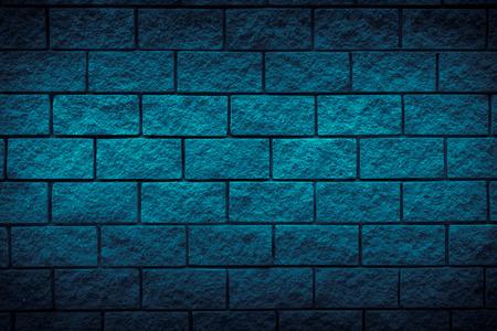 dark blue brick stone texture background. Free space for design. Blue wall background. Vignette.