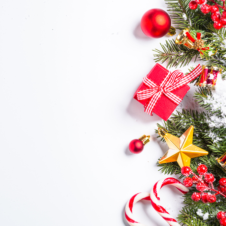 christmas background red and gold christmas decorations with snow fir tree branch on white background