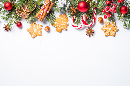 Christmas food background. Christmas cookies spices and  decorations on white background. Top view with copy space. Stock fotó