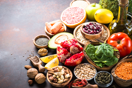 Superfood selection. Healthy nutrition. Legumes, grains, seeds, nuts avocado oil pomegranate grapefruit broccoli and spinach Stock Photo