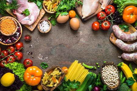 Food frame background. Organic food for healthy nutrition. Meat beans cheese pasta and vegetables. Top view copy space.