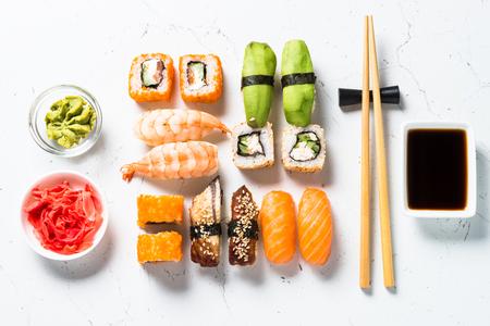Sushi and sushi roll set on white background.