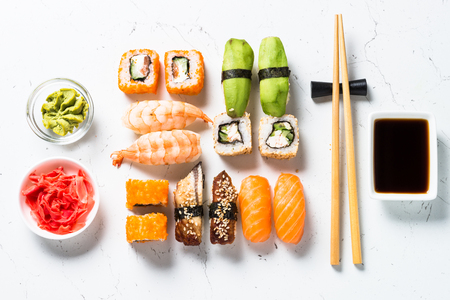 Sushi and sushi roll set on white background.
