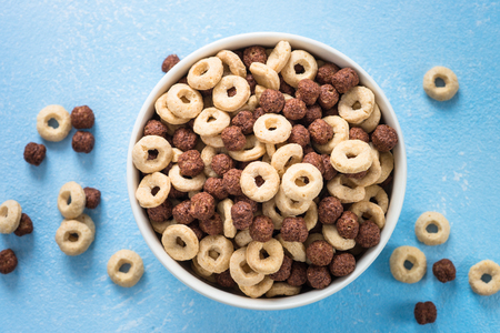 Healthy cereal breakfast on blue.