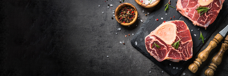 Raw beef steak osso bucco on black. Marble meat. Stock Photo