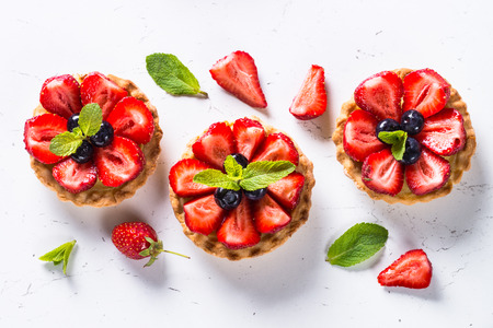 Strawberry tart on white. Imagens