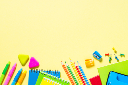 School and office stationery on yellow background.
