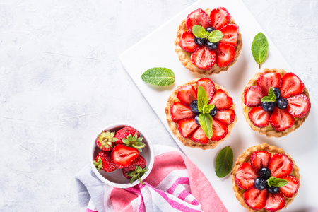 Strawberry tart on white table. Top view. Standard-Bild