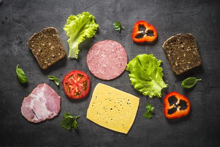 Ingredients for sandwich on a black background. Standard-Bild