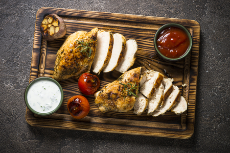 Chicken steak with sauces top view. Stock Photo
