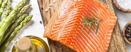 Salmon fillet with ingredients for cooking -  fresh vegetables a Stock Photo