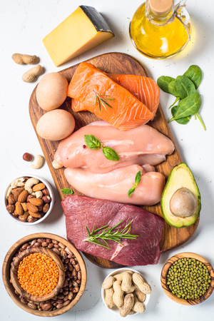 Protein sources - meat, fish, cheese, nuts, beans and greens. 免版税图像 - 110761084
