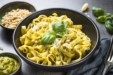 Tagliatelle pasta with pesto sauce and parmesan.