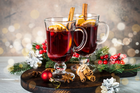Mulled wine in glass mug with fruit and spices. Stock Photo
