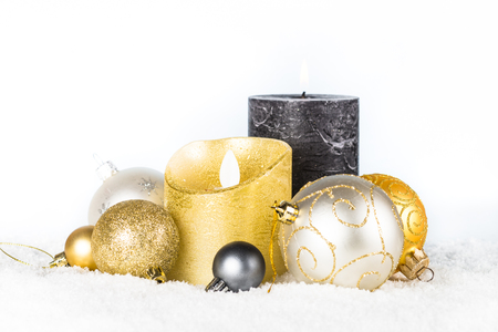 Christmas background. Silver and golden decorations in snow.