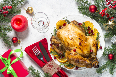 Chrismas chicken baked with cranberry, orange and rosemary. Christmas food.