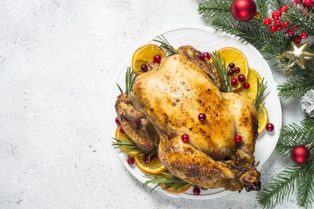 Chrismas chicken baked with cranberry, orange and rosemary. Christmas food. Stock Photo