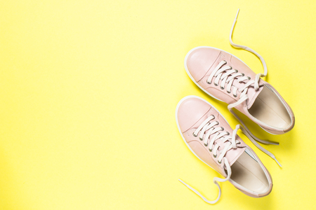 Woman fashion pink shoes on yellow background. Foto de archivo